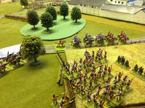 The Light Infantry advancing through the field with Cavalry on the road