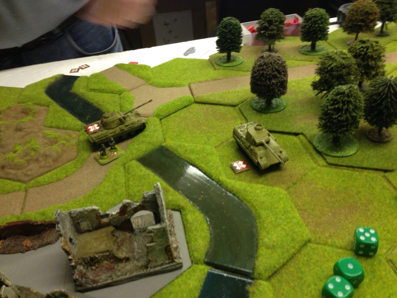German armour cross the river and start to surround the town