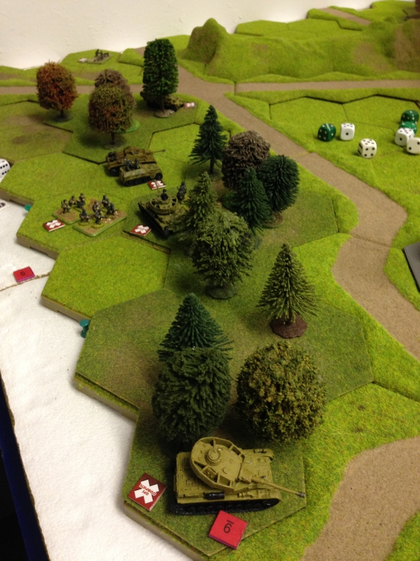 Panzers and Mech infantry take the woods to the left but not without loss